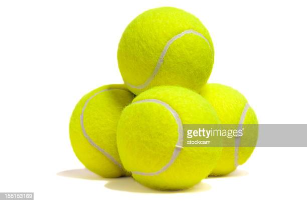isolated yellow tennis ball pyramid - tennis ball stock pictures, royalty-free photos & images