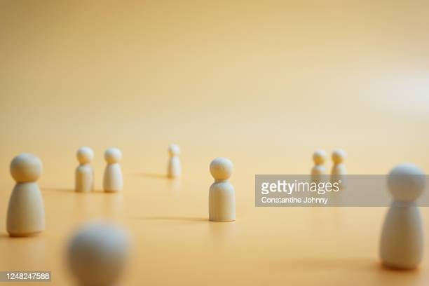 isolation. social distancing concept with wooden figurines. - avoidance stock pictures, royalty-free photos & images