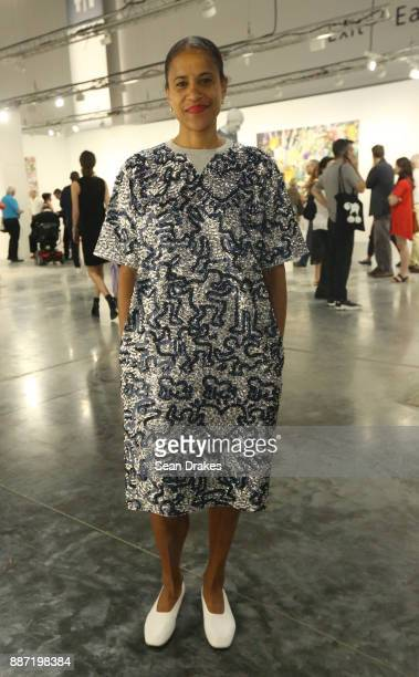 Isolde Brielmaier Director of Arts and Culture at Westfield World Trade Center wearing a silver sequined dress from the Coach x Keith Haring...