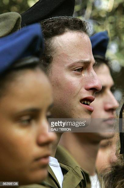 A tear rolls down the cheek of a comrade of slain Israeli soldier Sgt Nir Kahana during his funeral at the military cemetery in the northern Israeli...