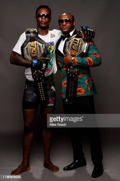 Israel Adesanya and Kamaru Usman pose for a post fight portrait backstage during the UFC 236 event at State Farm Arena on April 13 2019 in Atlanta...