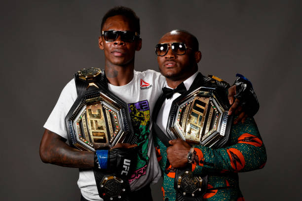 Israel Adesanya and Kamaru Usman pose for a post fight portrait backstage during the UFC 236 event at State Farm Arena on April 13, 2019 in Atlanta,...