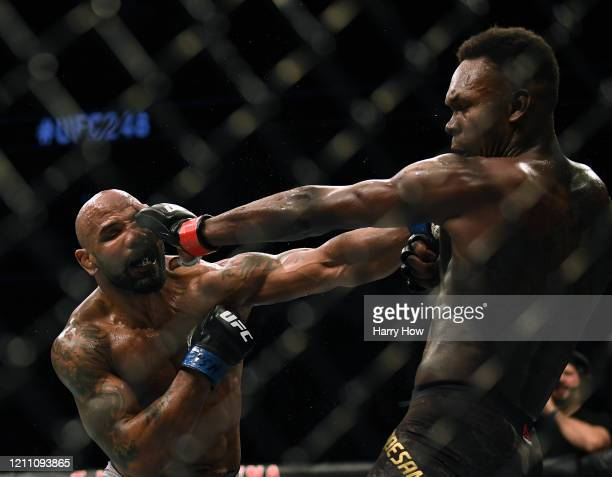 Israel Adesanya and Yoel Romero exchange punches in a Adesanya decision win to retain the middleweight title at TMobile Arena on March 07 2020 in Las...