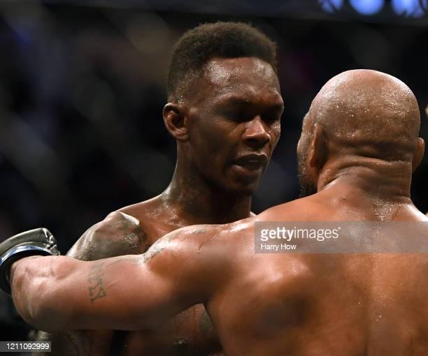 Israel Adesanya and Yoel Romero talk after a decision win to retain the middleweight title at TMobile Arena on March 07 2020 in Las Vegas Nevada