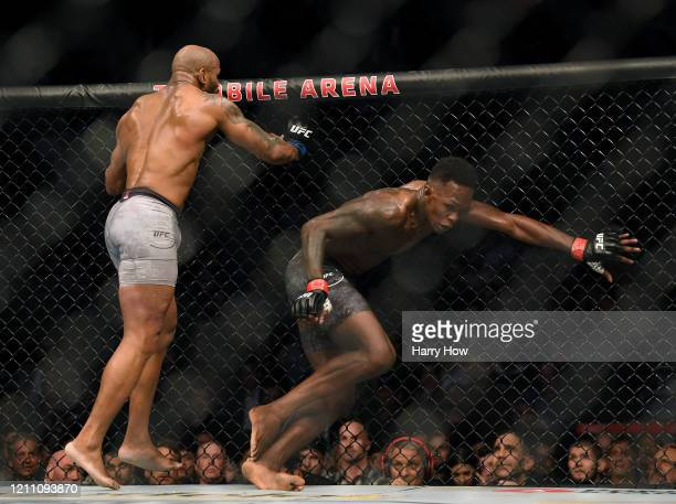 Israel Adesanya avoids Yoel Romero in a Adesanya decision win to retain the middleweight title at TMobile Arena on March 07 2020 in Las Vegas Nevada