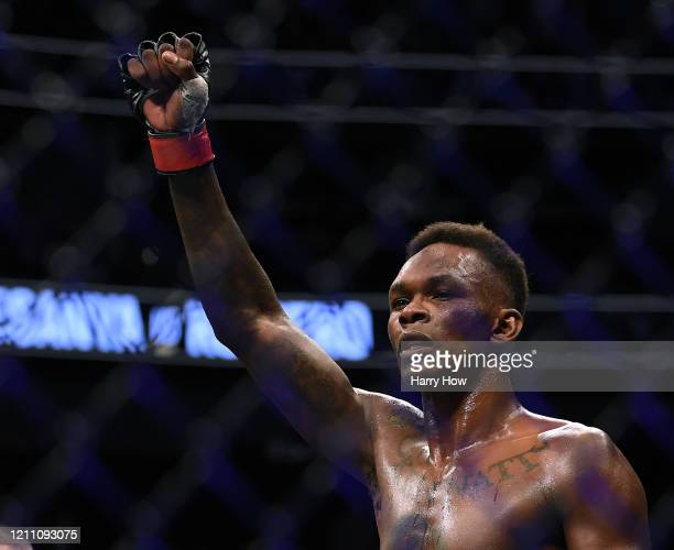 Israel Adesanya celebrates a decision win over Yoel Romero during a middleweight title bout at TMobile Arena on March 07 2020 in Las Vegas Nevada