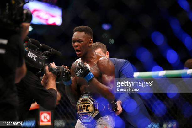 Israel Adesanya celebrates his victory over Robert Whittaker between in their Middleweight title bout during UFC 243 at Marvel Stadium on October 06...