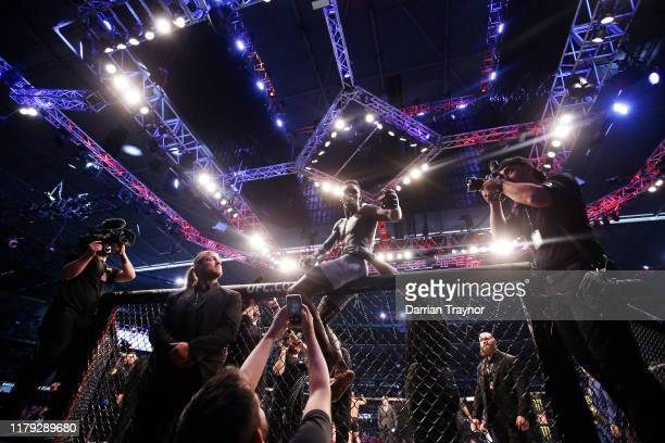 Israel Adesanya celebrates his victory over Robert Whittaker between in their Middleweight title bout during UFC 243 at Marvel Stadium on October 06,...