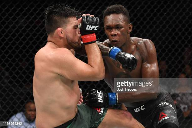 Israel Adesanya elbows Kelvin Gastelum in their interim middleweight championship bout during the UFC 236 event at State Farm Arena on April 13 2019...