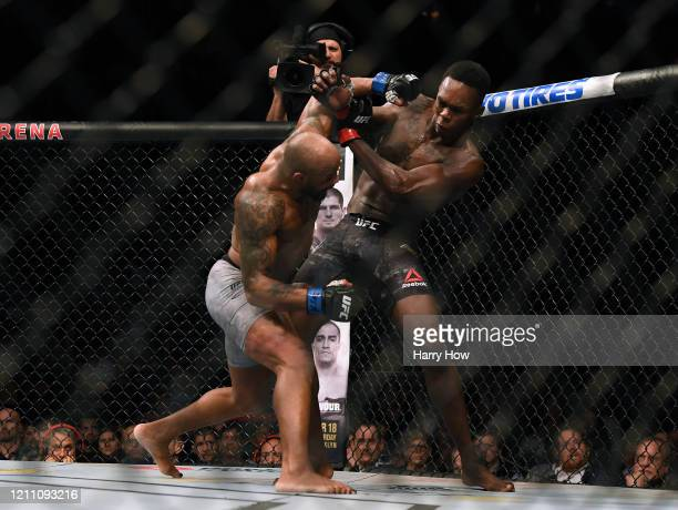 Israel Adesanya fends off Yoel Romero in a Adesanya decision win to retain the middleweight title at TMobile Arena on March 07 2020 in Las Vegas...