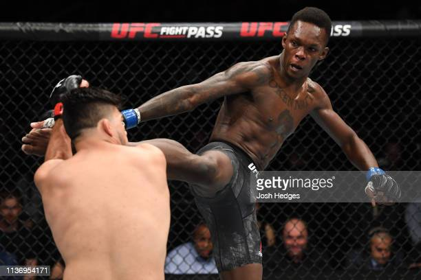 Israel Adesanya kicks Kelvin Gastelum in their interim middleweight championship bout during the UFC 236 event at State Farm Arena on April 13 2019...