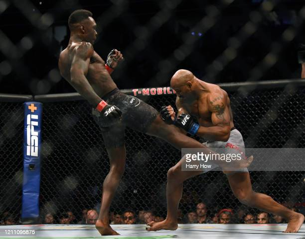 Israel Adesanya kicks Yoel Romero in a Adesanya decision win to retain the middleweight title at TMobile Arena on March 07 2020 in Las Vegas Nevada