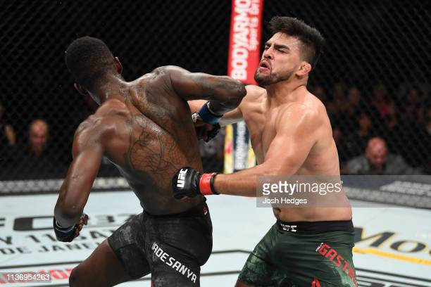 Israel Adesanya lands a spinning reverse elbow against Kelvin Gastelum in their interim middleweight championship bout during the UFC 236 event at...