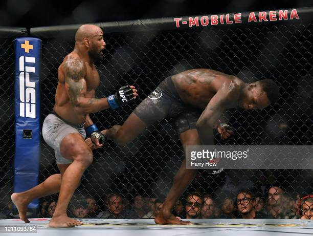 Israel Adesanya moves from Yoel Romero in a Adesanya decision win to retain the middleweight title at TMobile Arena on March 07 2020 in Las Vegas...