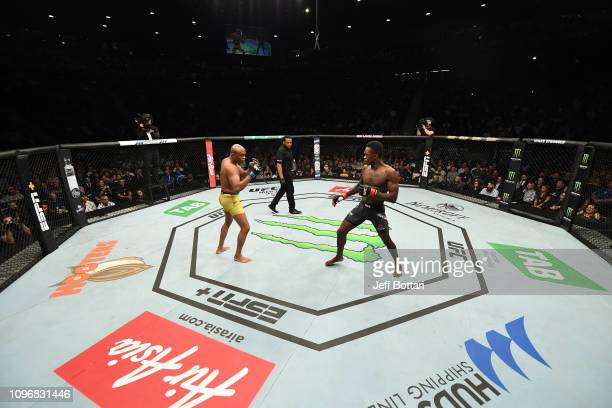 Israel Adesanya of New Zealand and Anderson Silva of Brazil battle in their middleweight bout during the UFC 234 at Rod Laver Arena on February 10...