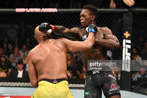 Israel Adesanya of New Zealand and Anderson Silva of Brazil exchange punches in their middleweight bout during the UFC 234 at Rod Laver Arena on...