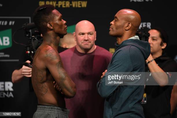 Israel Adesanya of New Zealand and Anderson Silva of Brazil face off during the UFC 234 weighin at Rod Laver Arena on February 09 2019 in the...
