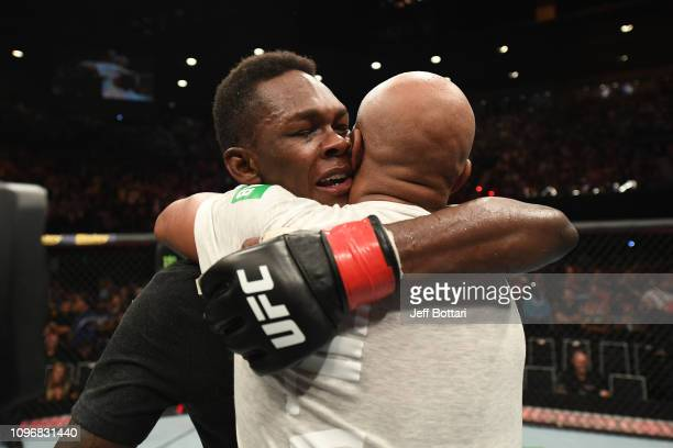 Israel Adesanya of New Zealand and Anderson Silva of Brazil hug after their middleweight bout during the UFC 234 at Rod Laver Arena on February 10...