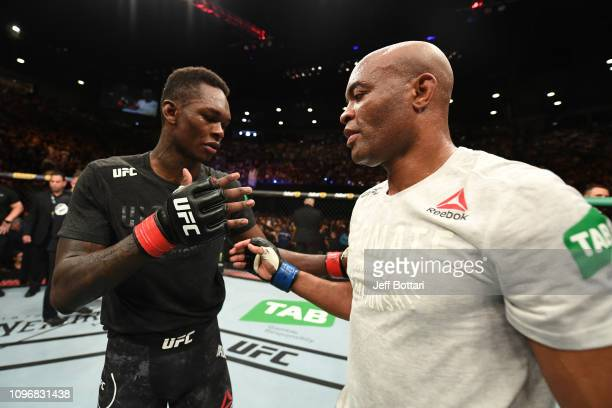 Israel Adesanya of New Zealand and Anderson Silva of Brazil shake hands after their middleweight bout during the UFC 234 at Rod Laver Arena on...