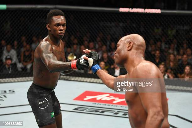 Israel Adesanya of New Zealand and Anderson Silva of Brazil touch gloves in their middleweight bout during the UFC 234 at Rod Laver Arena on February...
