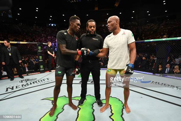 Israel Adesanya of New Zealand and Anderson Silva of Brazil touch gloves after their middleweight bout during the UFC 234 at Rod Laver Arena on...