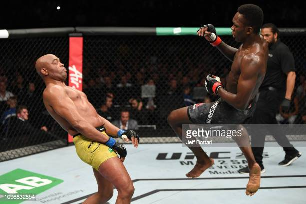 Israel Adesanya of New Zealand attempts to kick Anderson Silva of Brazil in their middleweight bout during the UFC 234 at Rod Laver Arena on February...