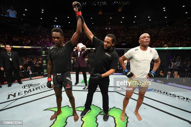 Israel Adesanya of New Zealand celebrates his victory over Anderson Silva of Brazil in their middleweight bout during the UFC 234 at Rod Laver Arena...