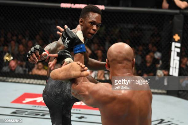 Israel Adesanya of New Zealand kicks Anderson Silva of Brazil in their middleweight bout during the UFC 234 at Rod Laver Arena on February 10 2019 in...