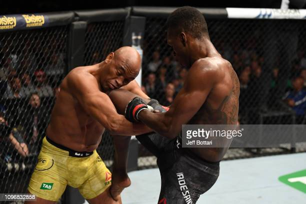 Israel Adesanya of New Zealand knees Anderson Silva of Brazil in their middleweight bout during the UFC 234 at Rod Laver Arena on February 10 2019 in...