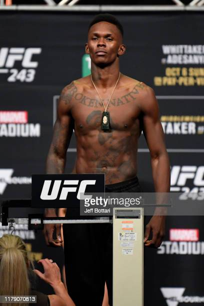 Israel Adesanya of New Zealand poses on the scale during the UFC 243 weigh-in at Marvel Stadium on October 05, 2019 in Melbourne, Australia.