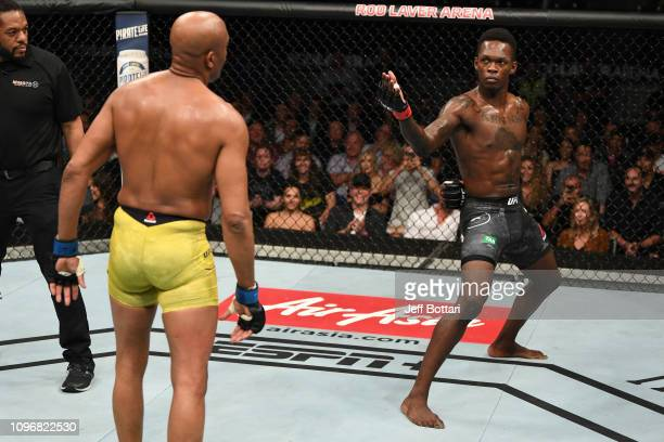 Israel Adesanya of New Zealand taunts Anderson Silva of Brazil in their middleweight bout during the UFC 234 at Rod Laver Arena on February 10 2019...