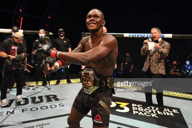 Israel Adesanya of Nigeria celebrates after defeating Paulo Costa of Brazil in their middleweight championship bout during UFC 253 inside Flash Forum...