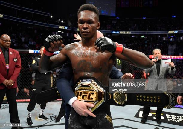 Israel Adesanya of Nigeria celebrates after defeating Yoel Romero of Cuba in their UFC middleweight championship fight during the UFC 248 event at...