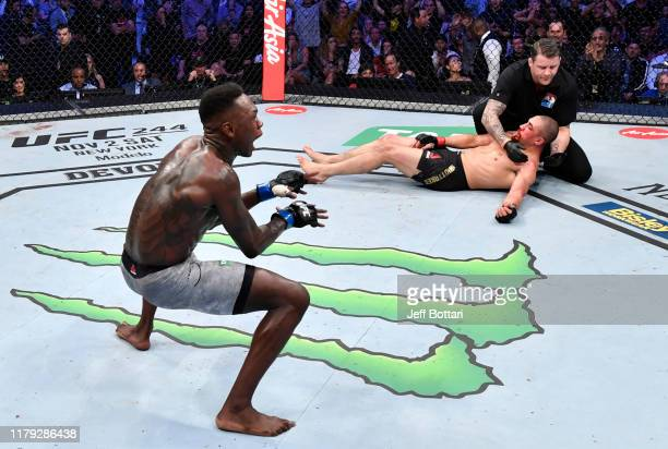 Israel Adesanya of Nigeria celebrates after his knockout victory over Robert Whittaker of New Zealand in their UFC middleweight championship fight...