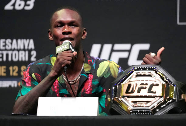 Israel Adesanya of Nigeria interacts with media during the UFC 263 press conference at Arizona Federal Theater on June 10, 2021 in Phoenix, Arizona.