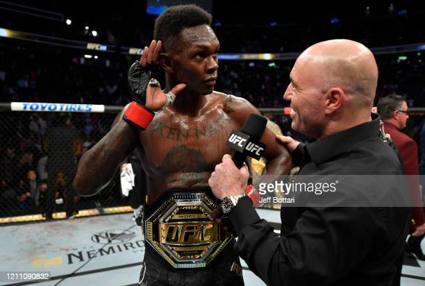 Israel Adesanya of Nigeria is interviewed after defeating Yoel Romero of Cuba in their UFC middleweight championship fight during the UFC 248 event...