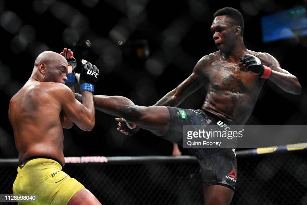 Israel Adesanya of Nigeria kicks Anderson Silva of Brazil during their Middleweight bout during UFC234 at Rod Laver Arena on February 10 2019 in...