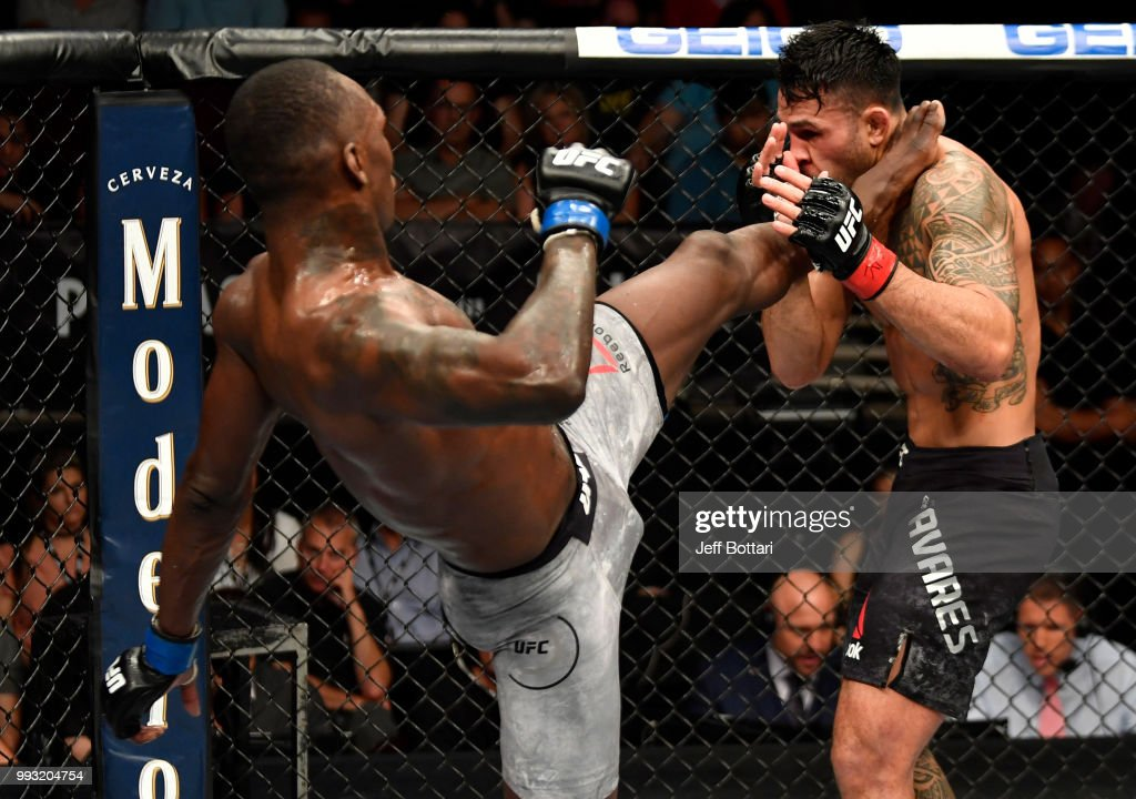 Israel Adesanya of Nigeria kicks Brad Tavares in their middleweight bout during The Ultimate Fighter Finale event inside The Pearl concert theater at Palms Casino Resort on July 6, 2018 in Las Vegas, Nevada.