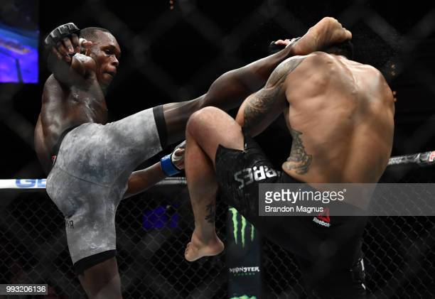 Israel Adesanya of Nigeria kicks Brad Tavares in their middleweight bout during The Ultimate Fighter Finale event inside The Pearl concert theater at...
