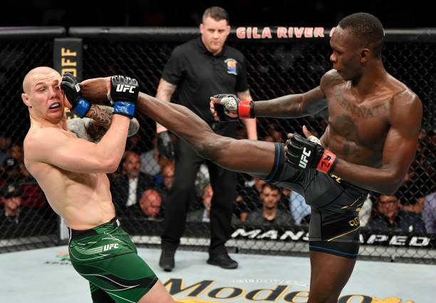 Israel Adesanya of Nigeria kicks Marvin Vettori of Italy in their UFC middleweight championship fight during the UFC 263 event at Gila River Arena on...