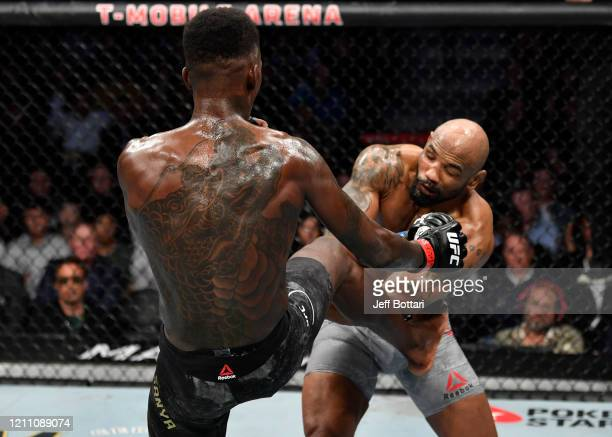 Israel Adesanya of Nigeria kicks Yoel Romero of Cuba in their UFC middleweight championship fight during the UFC 248 event at TMobile Arena on March...