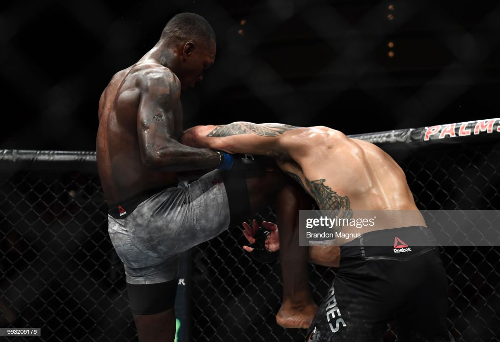 Israel Adesanya of Nigeria knees Brad Tavares in their middleweight bout during The Ultimate Fighter Finale event inside The Pearl concert theater at Palms Casino Resort on July 6, 2018 in Las Vegas, Nevada.