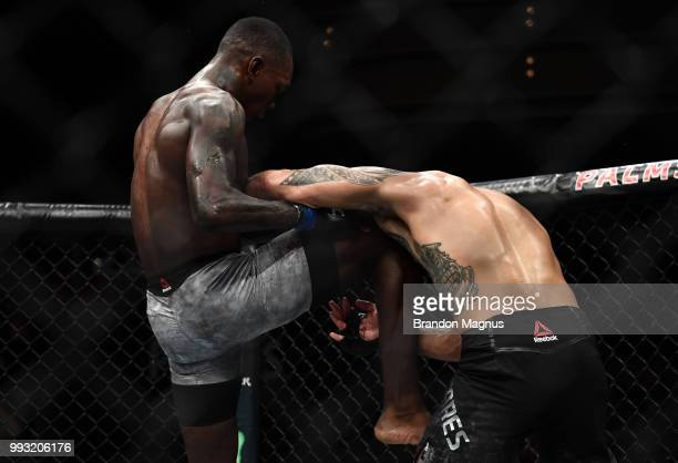Israel Adesanya of Nigeria knees Brad Tavares in their middleweight bout during The Ultimate Fighter Finale event inside The Pearl concert theater at...