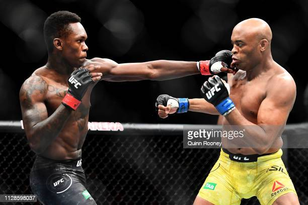 Israel Adesanya of Nigeria punches Anderson Silva of Brazil during their Middleweight bout during UFC234 at Rod Laver Arena on February 10 2019 in...