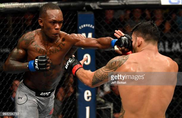 Israel Adesanya of Nigeria punches Brad Tavares in their middleweight bout during The Ultimate Fighter Finale event inside The Pearl concert theater...