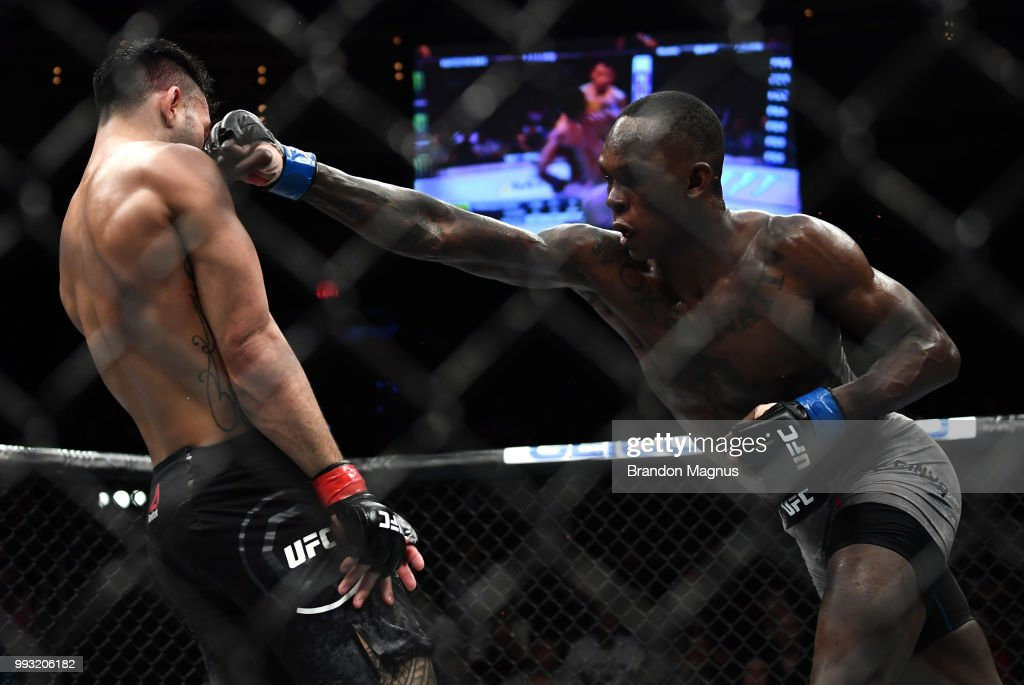 Israel Adesanya of Nigeria punches Brad Tavares in their middleweight bout during The Ultimate Fighter Finale event inside The Pearl concert theater at Palms Casino Resort on July 6, 2018 in Las Vegas, Nevada.