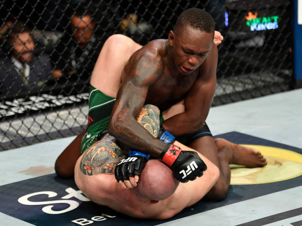 Israel Adesanya of Nigeria punches Marvin Vettori of Italy in their UFC middleweight championship fight during the UFC 263 event at Gila River Arena...