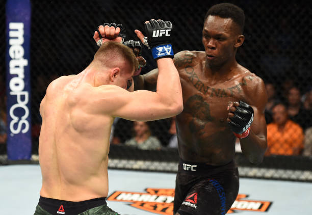 Israel Adesanya of Nigeria punches Marvin Vettori of Italy in their middleweight fight during the UFC Fight Night event at the Gila Rivera Arena on...