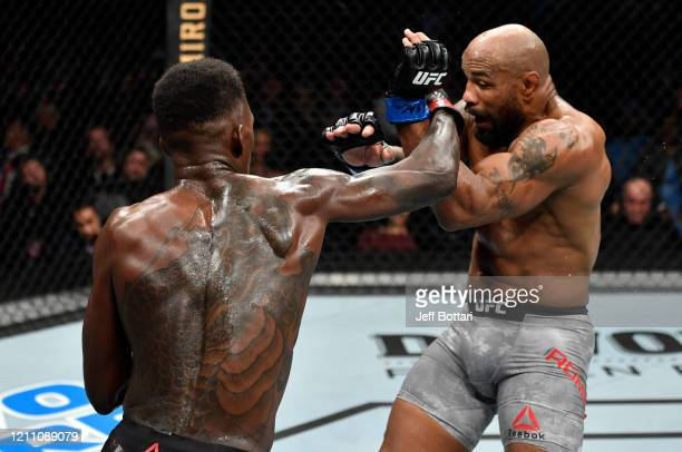 Israel Adesanya of Nigeria punches Yoel Romero of Cuba in their UFC middleweight championship fight during the UFC 248 event at TMobile Arena on...