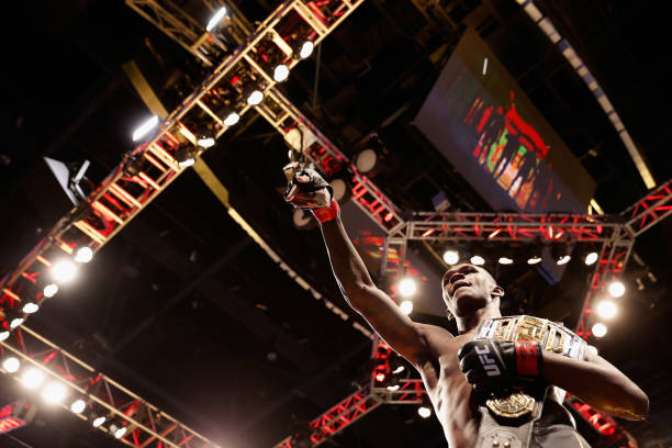 Israel Adesanya of Nigeria reacts after defeating Marvin Vettori of Italy by unanimous decision to win the middleweight championship during their UFC...